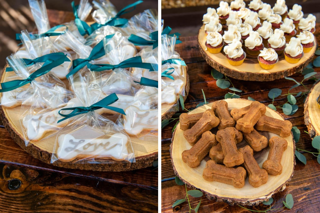 Bamboo Garden Wedding Reception Dessert Table, Rustic Wooden Serving Platters with Cupcakes and Dog Inspired Cookies | Tampa Bay Wedding Photographer Caroline and Evan Photography | Designer and Planner Southern Glam Weddings and Events | Wedding Cake Baker Artistic Whisk