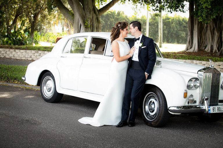 Tampa Bay Bride and Groom Outdoor Wedding Portrait in Front of White Vintage Rolls Royce Car