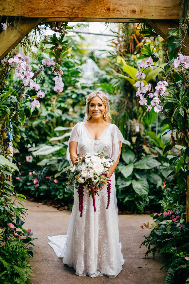Boho Chic Bride Wedding Portrait in Garden with Ivory, White Anemones, Red Hanging Amaranthus and Greenery Flower Bouquet | Sarasota Wedding Venue Marie Selby Botanical Gardens