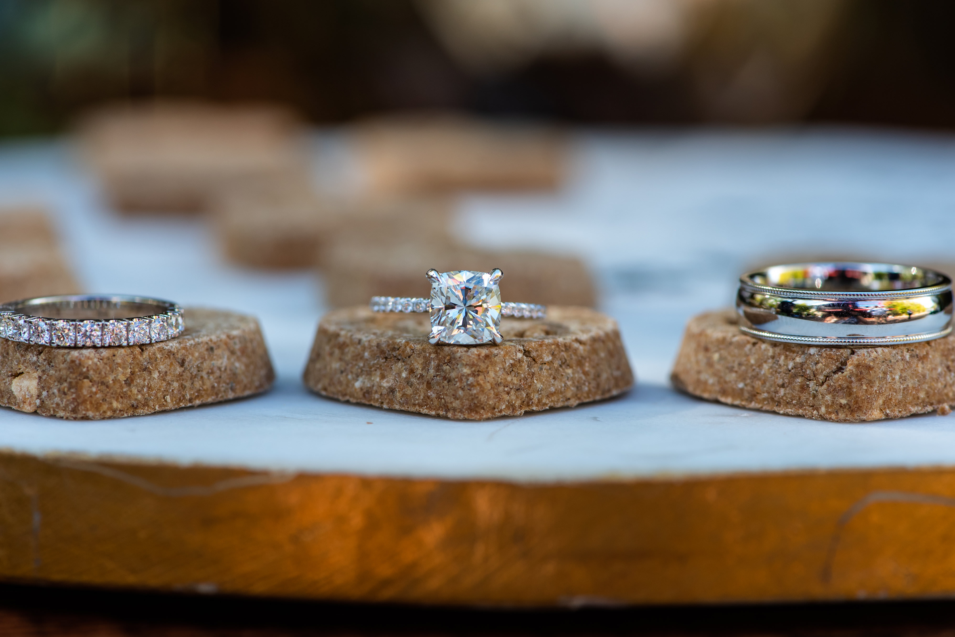 Cushion Cut Diamond Engagement Ring and Diamond Band, Bride and Groom Wedding Rings on Dog Biscuits | Tampa Bay Wedding Photographer Caroline and Evan Photography|