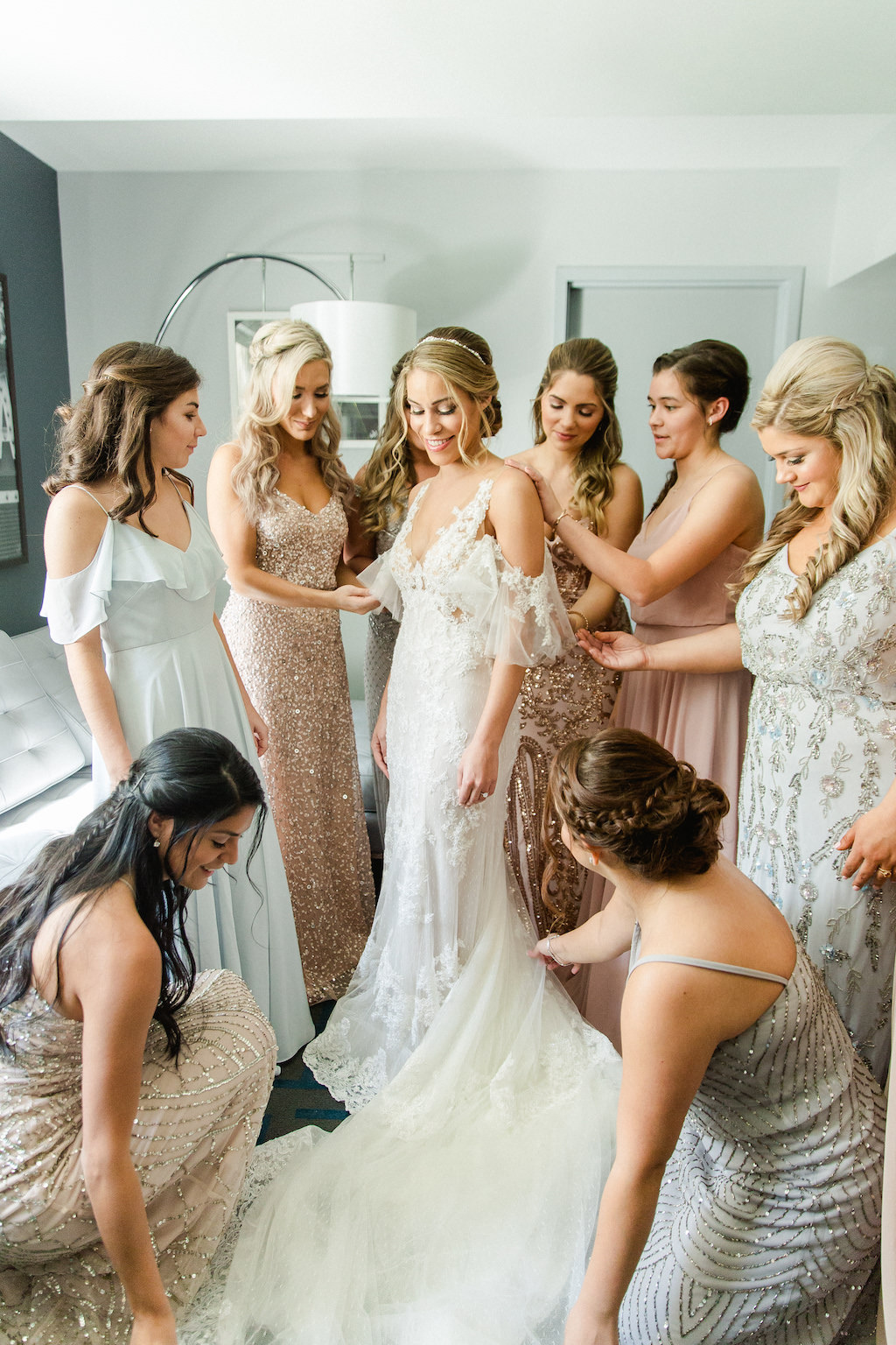 Florida Bride Getting Ready Wedding Portrait with Bridesmaids in Mismatched Rose Gold, Silver Dresses, Bride in Deep V Neckline Lace, Off the Shoulder Illusion Sleeves