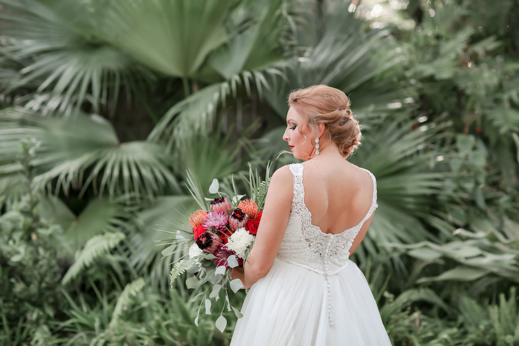 Florida Bride Outdoor Wedding Portrait with Tropical Floral Bouquet, Low Back Lace and Illusion Ballgown Wedding Dress | Tampa Bay Wedding Photographer Lifelong Photography Studio | Hair and Makeup Michele Renee the Studio