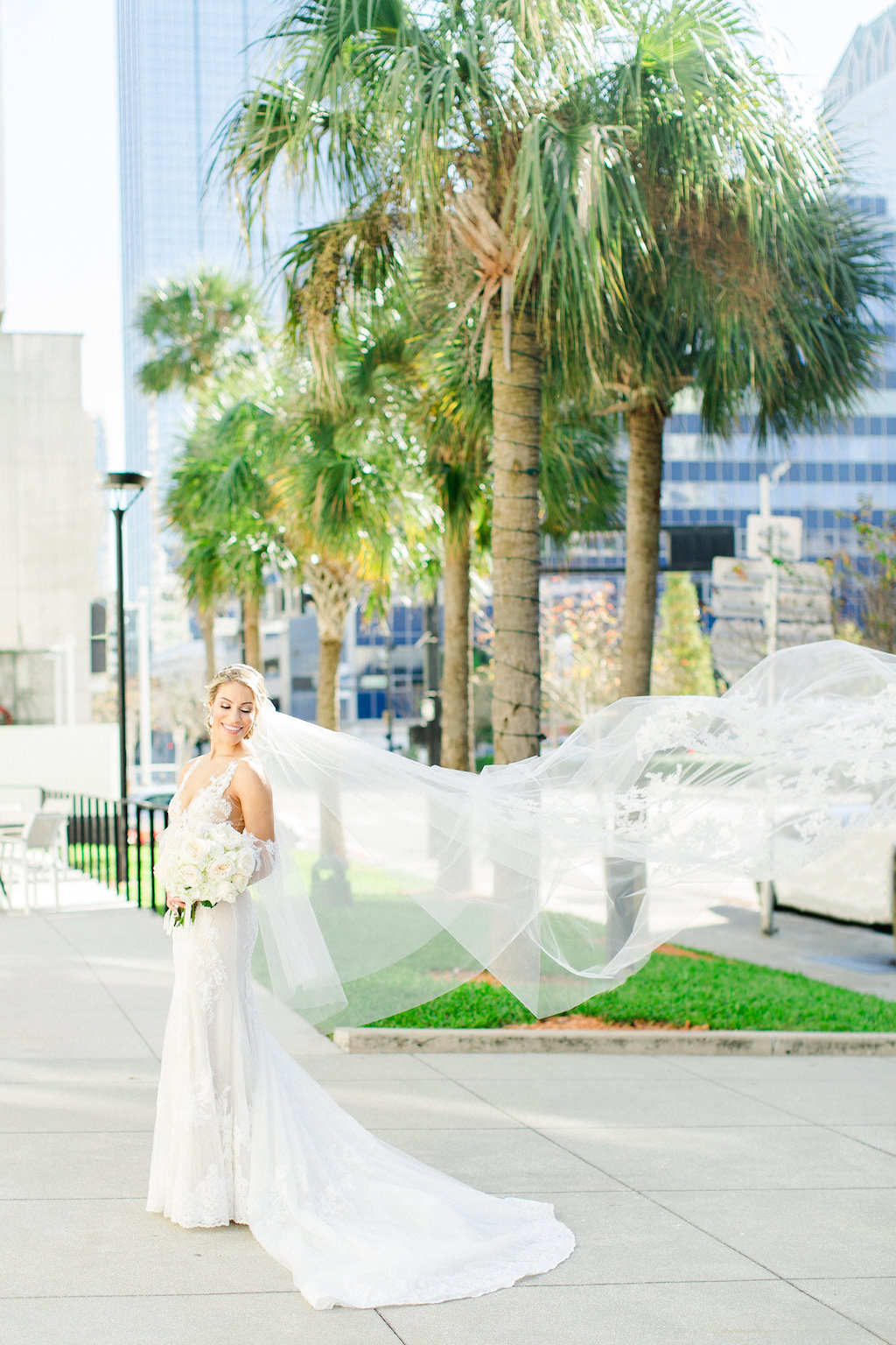Florida Outdoor Creative Wedding Portrait with Veil Blowing in Wind | Downtown Tampa
