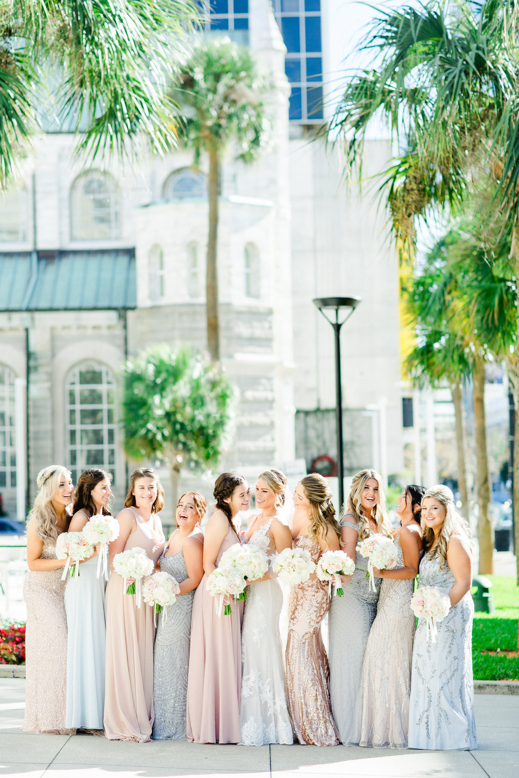 Downtown Tampa Outdoor Bride and Bridesmaids Bridal Party Wedding Portrait, Bridesmaids in Mismatched Blush Pink, Silver and Pale Blue Long Dresses with Ivory Floral Bouquets