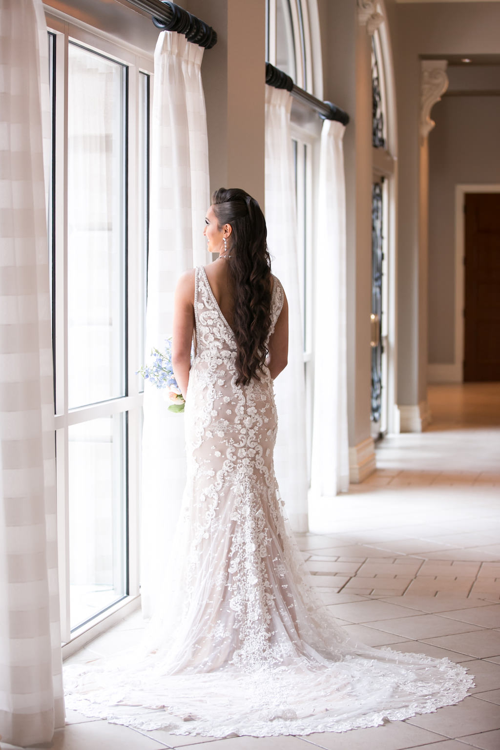 Tampa Bay Bride Wedding Portrait in Lace and Illusions V Shaped Open Back and Tank Top Straps Wedding Dress | Tampa Bay Photographer Carrie Wildes Photography | Hair and Makeup Destiny and Light Hair and Makeup Group | Wedding Dress Nikkk's Glitz and Glam Boutique | Wedding Venue Renaissance Tampa International Plaza