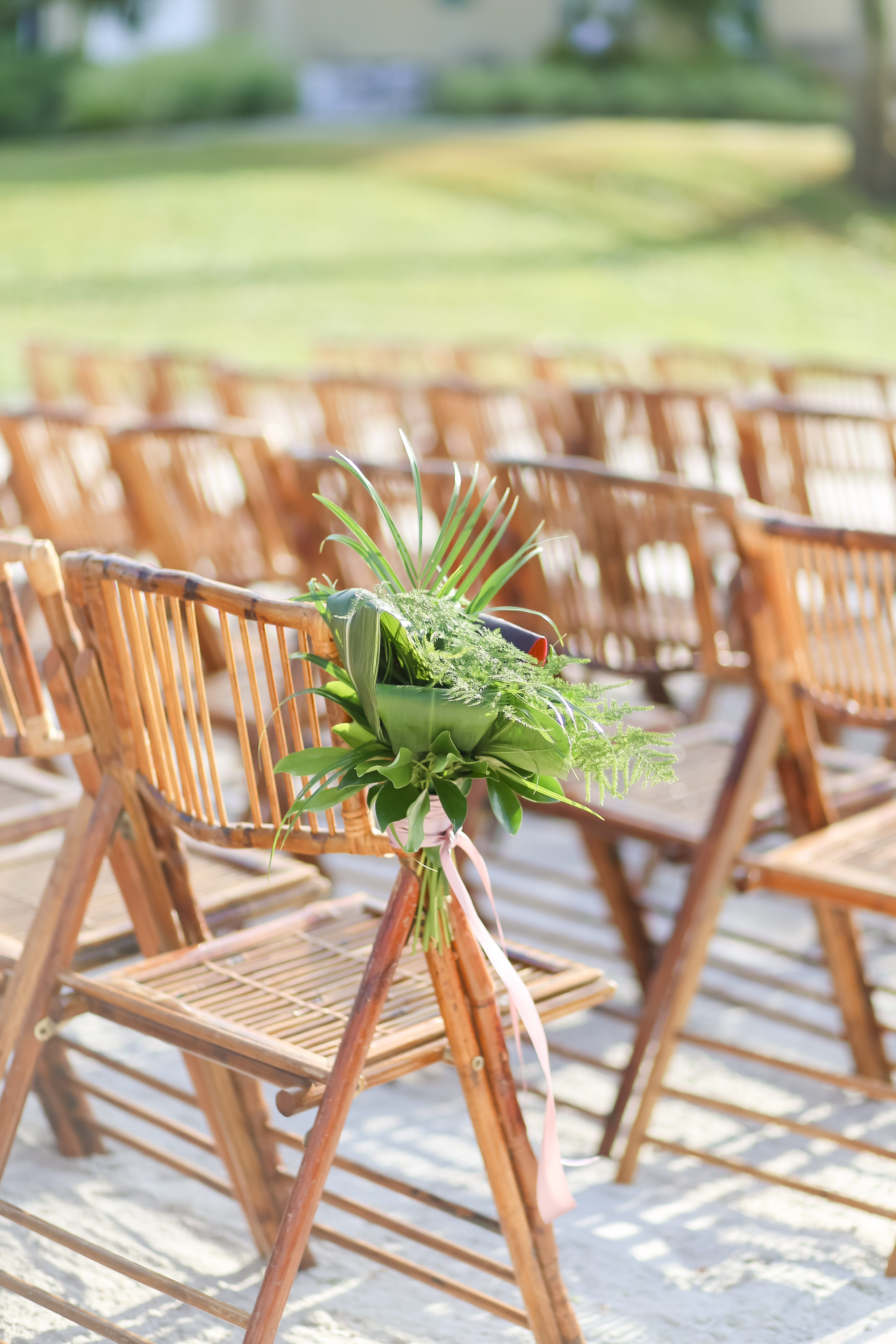 Florida Beach Elegant Wedding Ceremony Decor, Bamboo Wood Folding Chairs with Tropical Palm Leaf Tropical Floral Bouquet | Photographer LifeLong Photography Studios