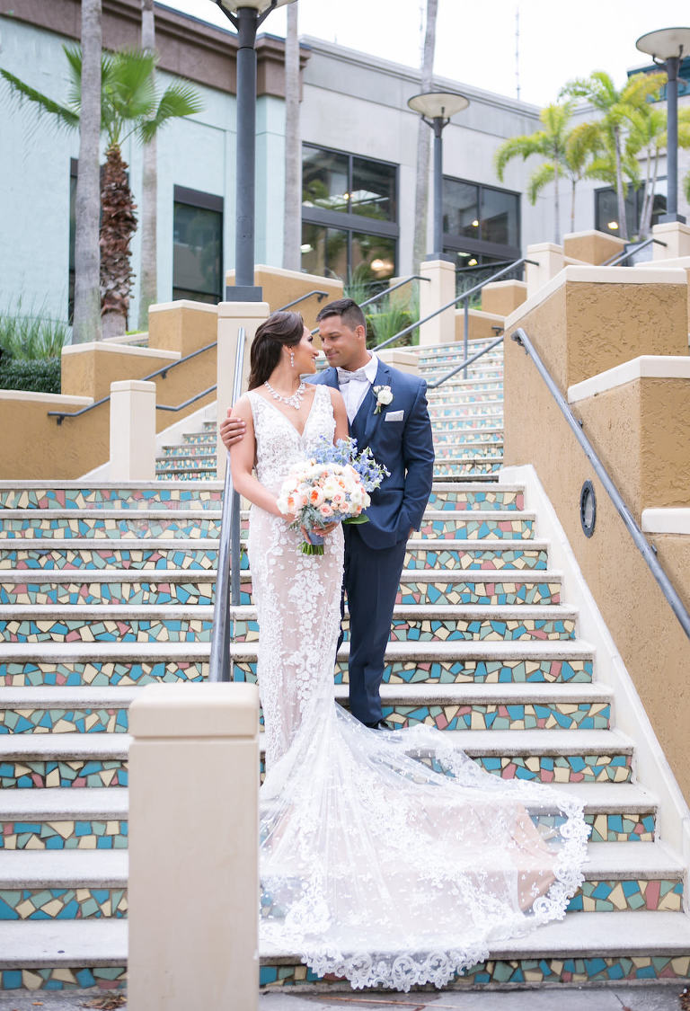 Florida Bride and Groom Staircase Wedding Portrait | Tampa Bay Photographer Carrie Wildes Photography | Hair and Makeup Destiny and Light Hair and Makeup Group | Wedding Attire Nikki's Glitz and Glam Boutique | Florist Gabro Event Services | Hotel Wedding Venue Renaissance Tampa International Plaza