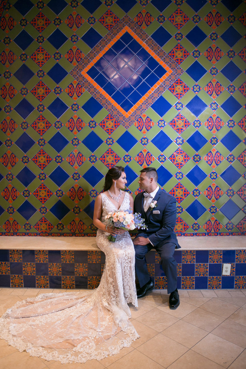 Florida Bride and Groom Wedding Portrait with Colorful Tile Backdrop | Tampa Bay Photographer Carrie Wildes Photography | Hair and Makeup Destiny and Light Hair and Makeup Group | Wedding Attire Nikki's Glitz and Glam Boutique | Florist Gabro Event Services | Hotel Wedding Venue Renaissance Tampa International Plaza