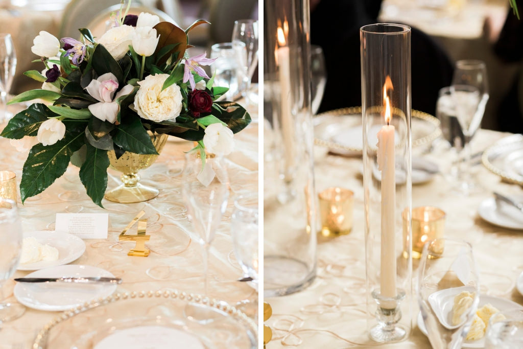 Classic, Tropical Inspired Wedding Reception Decor, Round Tables with Gold Tablecloths, Low Gold Vase with White, Dark Purple, Lilac, and Greenery Floral Centerpieces, Tall White Candlestick in Clear Cylinder Vase
