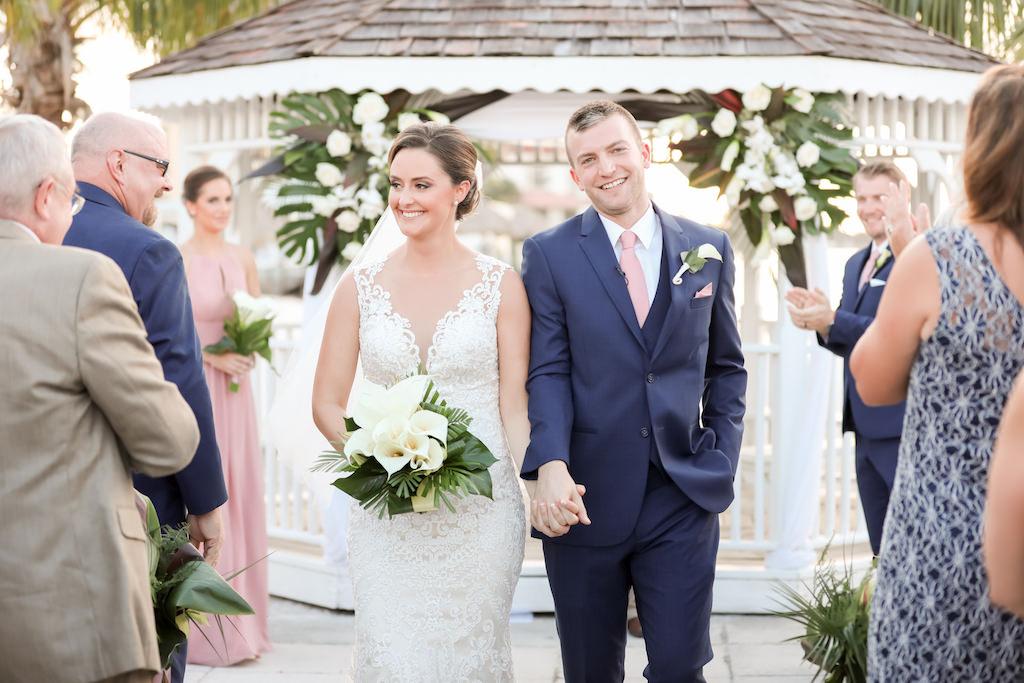 Florida Bride and Groom Beach Elegant Wedding Ceremony Exit Portrait at Waterfront Gazebo | Photographer LifeLong Photography Studios | St. Pete Beach Wedding Venue Isla Del Sol Yacht and Country Club