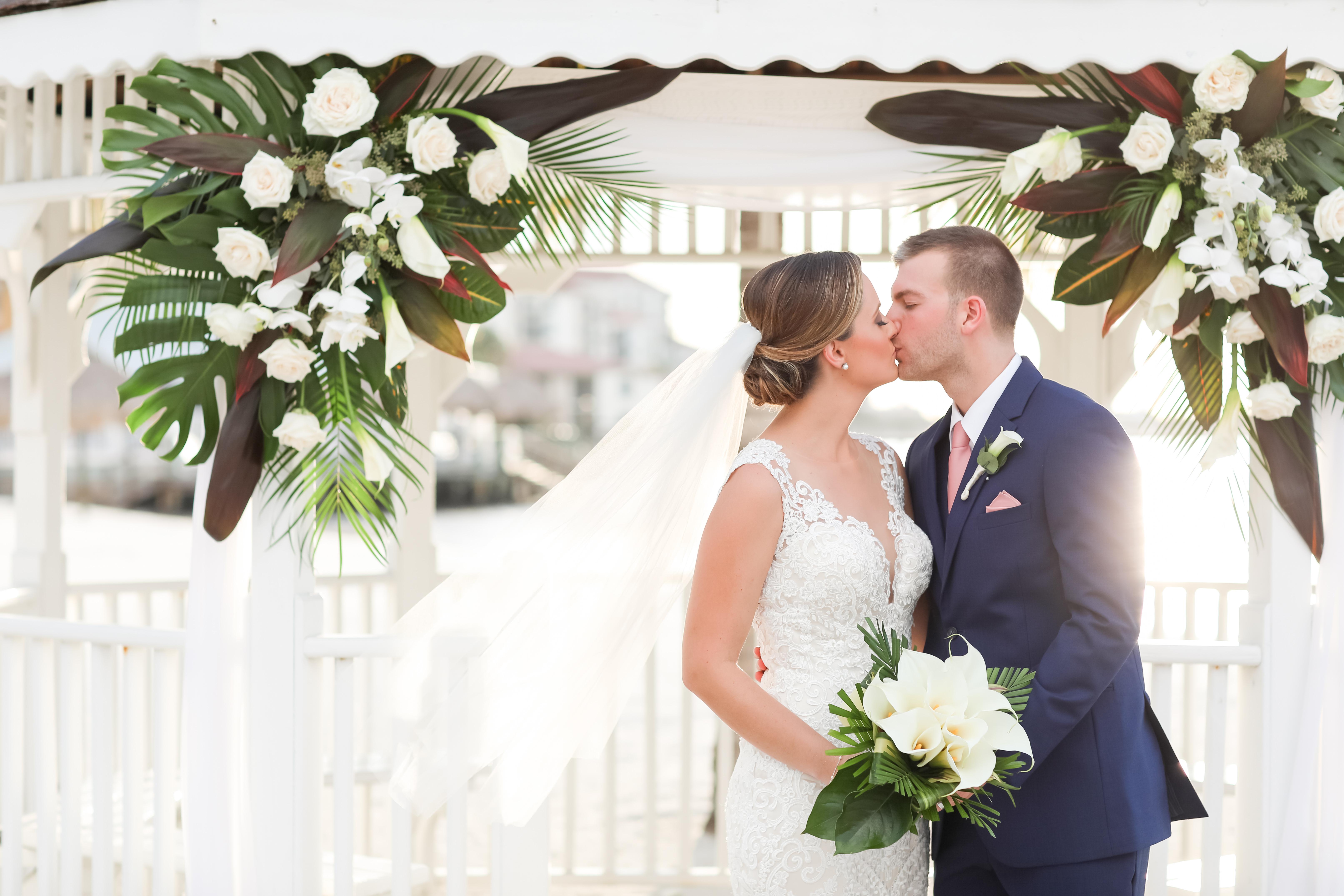 Florida Bride and Groom Intimate Beach Elegant Sunset Wedding Portrait at Waterfront Gazebo | Photographer LifeLong Photography Studios | St. Pete Beach Wedding Venue Isla Del Sol Yacht and Country Club