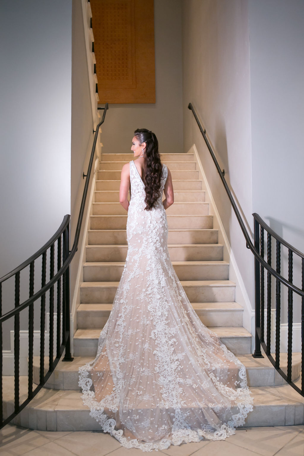 Florida Bride Wedding Portrait on Staircase, Lace and Illusion V Low Back and Tank Top Strap Wedding Dress | Tampa Bay Photographer Carrie Wildes Photography | Wedding Venue Tampa International Plaza | Hair and Makeup Destiny and Light Hair and Makeup Group | Wedding Dress Nikki's Glitz and Glam Boutique