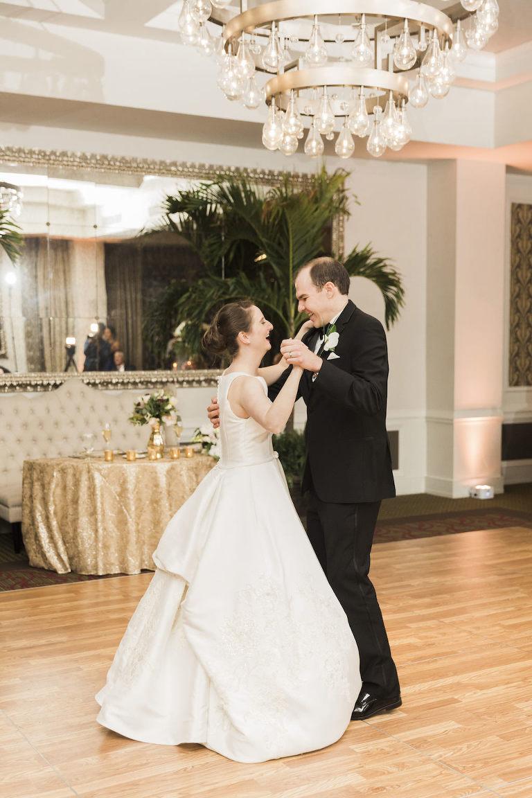 Tampa Bay Bride and Groom First Dance in Ballroom with Contemporary Chandelier | Tampa Bay Wedding Planner Love Lee Lane | St. Petersburg Wedding Venue The Birchwood | DJ Grant Hemond & Associates