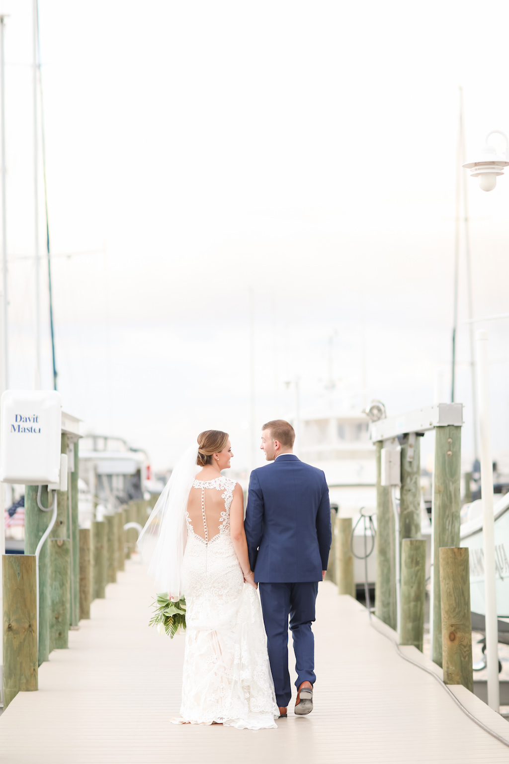 Tampa Bay Bride and Groom Yacht Pier Wedding Portrait | Photographer LifeLong Photography Studios | St. Pete Beach Waterfront Wedding Venue Isla Del Sol Yacht and Country Club