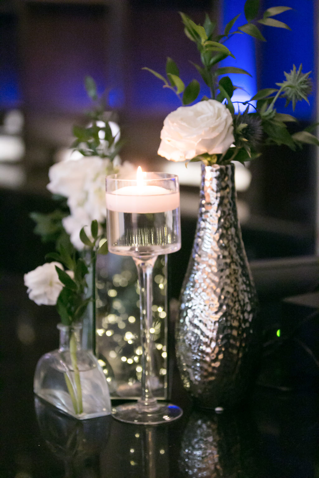 Wedding Reception Decor, Glass Candlestick with Floating Candle, Silver Vase with White Rose and Greenery Centerpiece | Tampa Bay Photographer Carrie Wildes Photography | Wedding Planner Coastal Coordinating | Florist Gabro Event Services