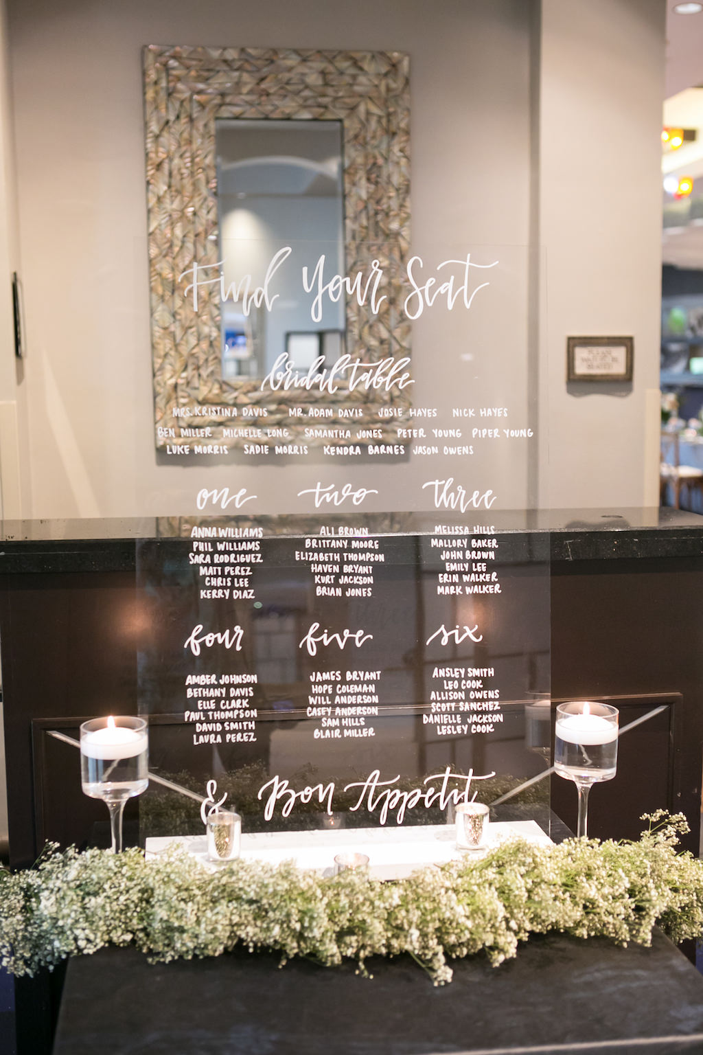 Wedding Reception Decor, Clear Acrylic Wedding Seating Chart with White Font, White Baby's Breathe Garland, Glass Candlesticks with Floating Candles | Tampa Bay Photographer Carrie Wildes Photography | Wedding Planner Coastal Coordinating | Rentals and Florist Gabro Event Services