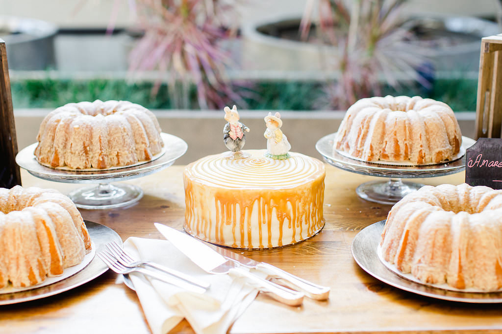Wedding Reception Dessert Table, Bundt Cakes and One Tier Cake with Caramel Drizzle and Vintage Rabbit Cake Toppers