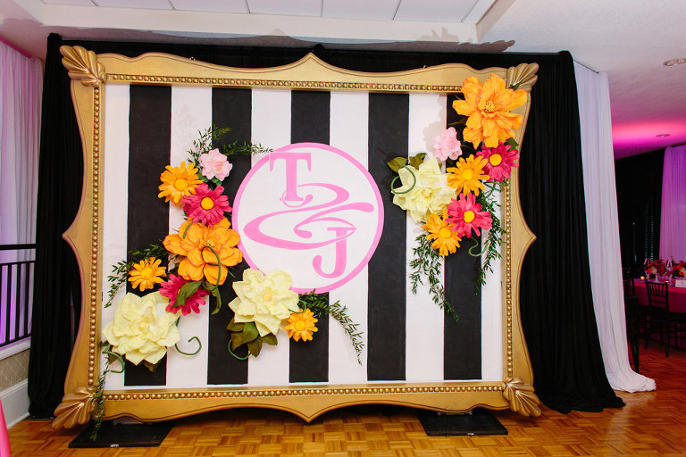 Whimsical Kate Spade Inspired Wedding Reception Decor, Large Gold Frame with Black and White Stripes, Pink Monogram, Colorful Paper Flowers | Tampa Bay Wedding Planner Parties A La Carte
