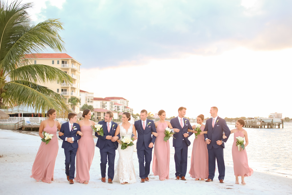 Florida Bride, Groom, Bridesmaids in Dusty Rose Mismatched Style Dresses and Groomsmen in Blue Suits with Pink Ties Wedding Party | Photographer LifeLong Photography Studios | St. Pete Beach Waterfront Wedding Venue Isla Del Sol Yacht and Country Club