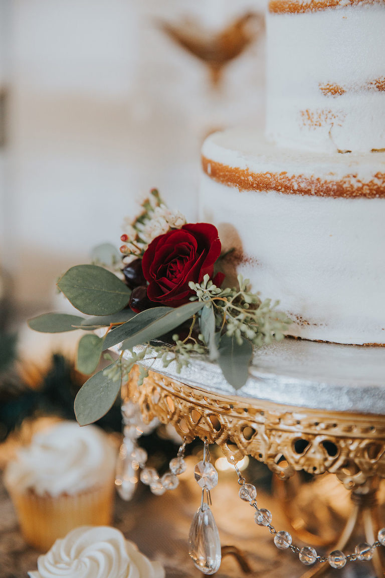 6ad609e6564e Two Tier Rustic Naked Half-Frosted White Wedding Cake with Rich Red Florals  and Greenery