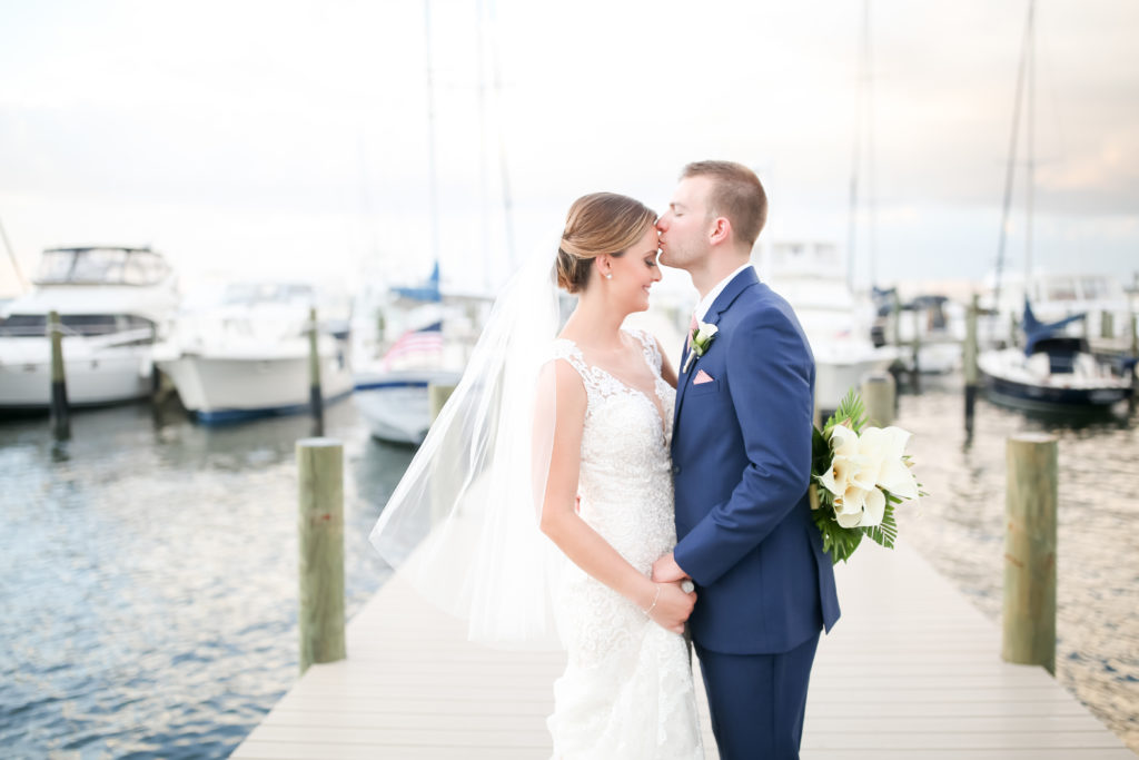 Florida Bride and Groom Sunset Waterfront Yacht Pier Wedding Portrait | Photographer LifeLong Photography Studios | St. Pete Beach Wedding Venue Isla Del Sol Yacht and Country Club | Hair and Makeup Michele Renee The Studio