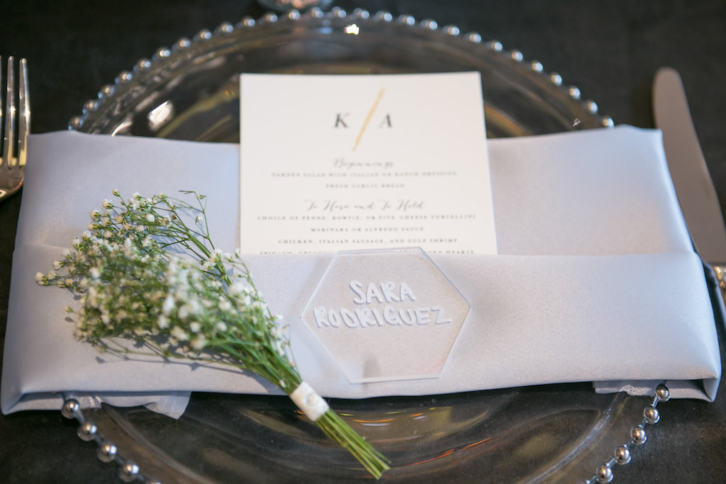 Garden Inspired Wedding Reception Decor, Clear and Silver Beaded Charger, White Line, Clear Acrylic Escort Card, Baby's Breath, Menu | Tampa Bay Photographer Carrie Wildes Photography | Planner and Place Cards Coastal Coordinating | Linen Rentals Gabro Event Services