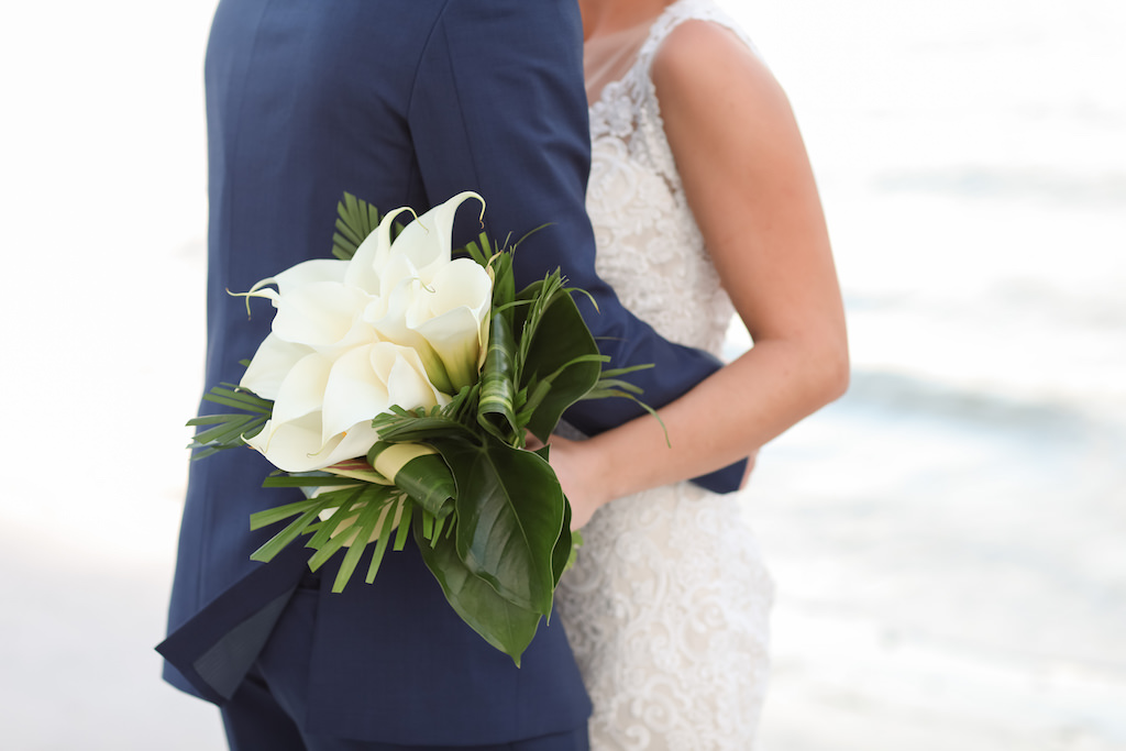 Tampa Bay Bride and Groom Waterfront Wedding Portrait, Bride with White Tropical Cala Lily and Palm Leaf Floral Bouquet | Photographer LifeLong Photography Studios