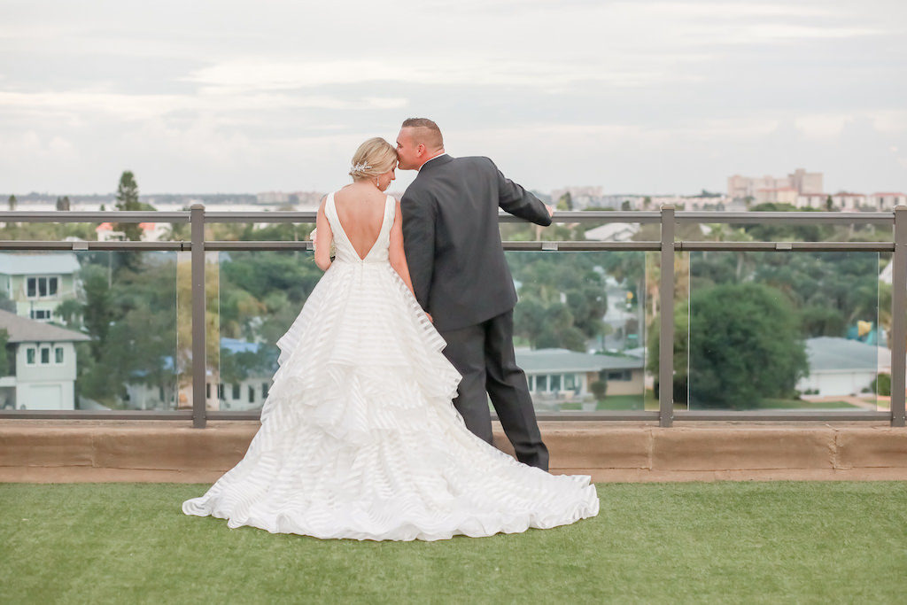 Florida Bride and Groom Hotel Rooftop Terrace Wedding Portrait | Bride in Organza Flowy Low V-Back with Horsehair Edging, Thick Straps Morilee Ballgown Wedding Dress | Tampa Bay Wedding Photographer Lifelong Photography Studios | St. Pete Beach Wedding Venue Hotel Zamora | Dress Shop Truly Forever Bridal