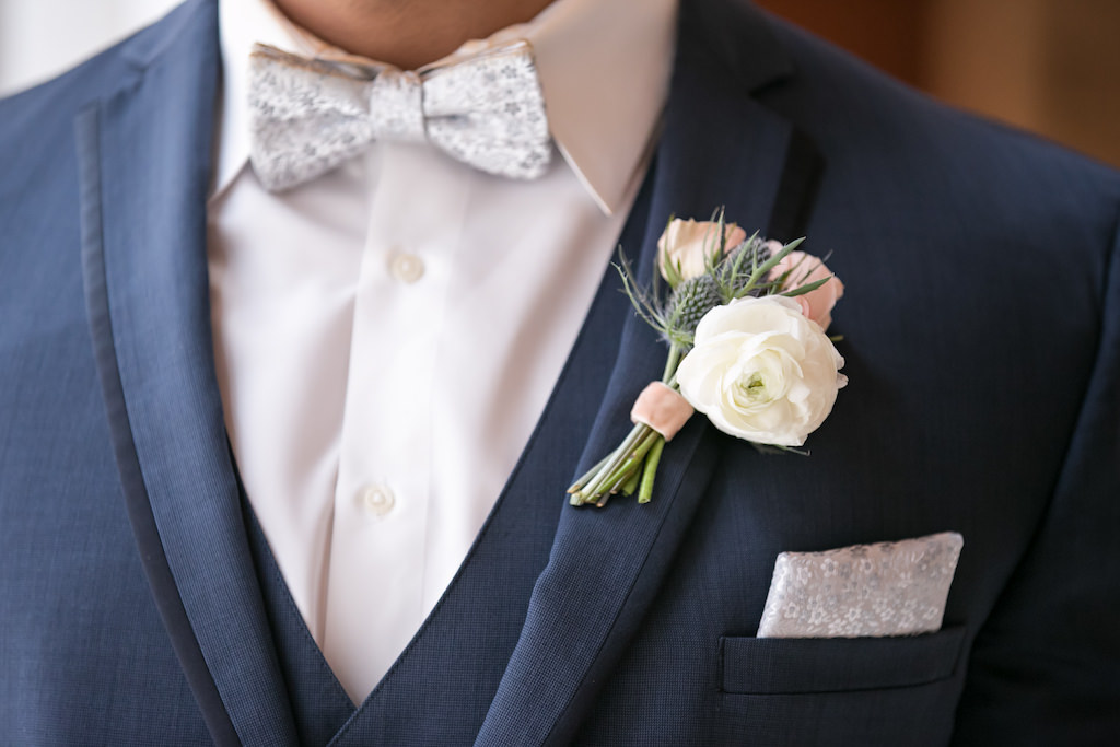 Tampa Bay Groom in Navy Blue Tuxedo, Silver Bowtie, White Rose and Blush Pink Rose Boutonniere | Photographer Carrie Wildes Photography | Florist Gabro Event Services | Tuxedo Shop Nikki's Glitz and Glam Boutique