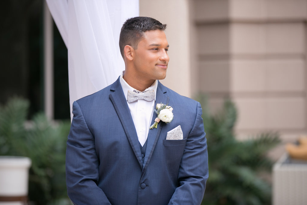 Tampa Bay Groom Wedding Portrait in Navy Blue Tuxedo, Silver Bowtie, White Rose and Blush Pink Rose Boutonniere | Photographer Carrie Wildes Photography | Florist Gabro Event Services | Tuxedo Shop Nikki's Glitz and Glam Boutique