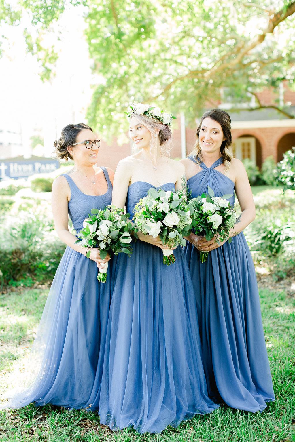 Tampa Bridesmaids in Mismatched Style Blue Dresses with Organic White, Ivory and Greenery Floral Bouquets