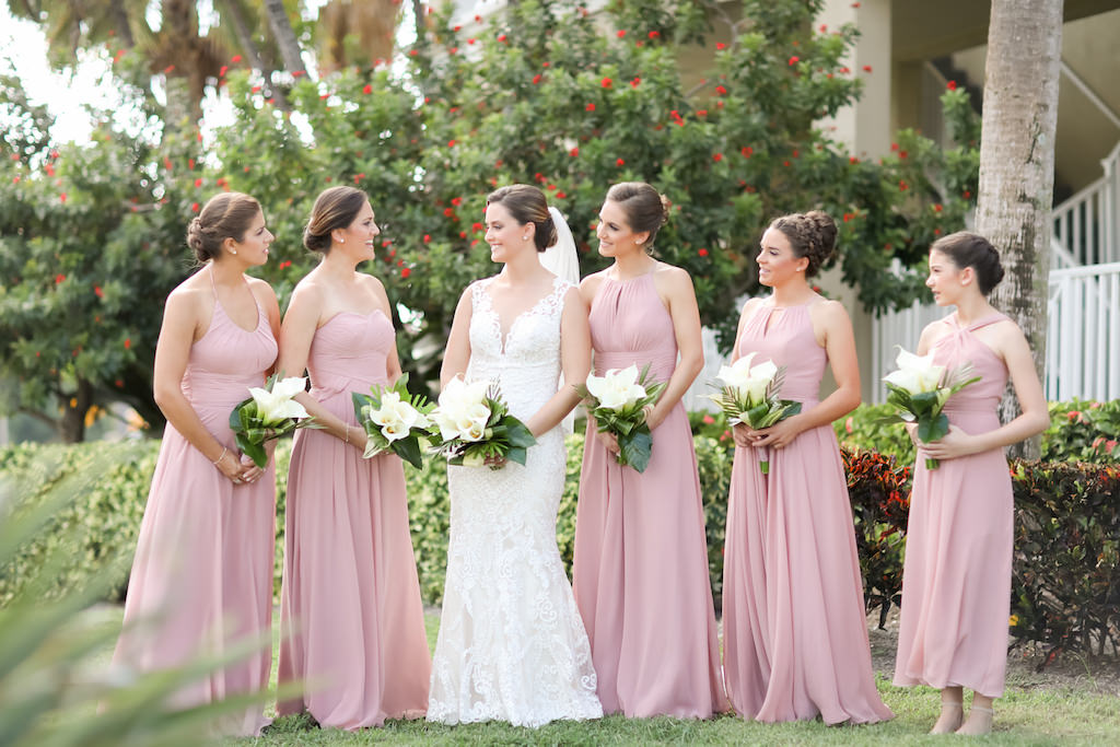 Florida Bride and Bridesmaids Outdoor Wedding Portrait, Bridesmaids in Mismatched Style Dusty Rose Dresses, Bride in Lace Fitted Sweetheart Neckline and Tank Top Strap Wedding Dress with White Cala Lily Floral Bouquets | Photographer LifeLong Photography Studios | Hair and Makeup Michele Renee the Studio