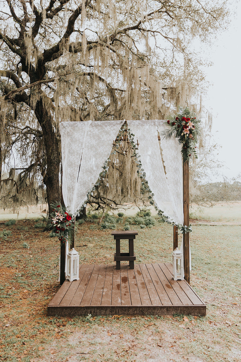 535ad52ec466 Rustic and Romantic Wooden Wedding Ceremony Arch on Platform with Lace  Drapes, Green Garland,