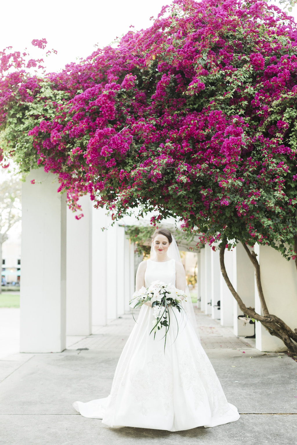 Florida Bride in White Traditional Sleeveless Randy Fenoli Kleinfeld Bridal Wedding Dress | White and Green Floral Bouquet | Outdoor Bridal Portraits Downtown St. Pete Straub Park | St. Petersburg Wedding Planner Love Lee Lane