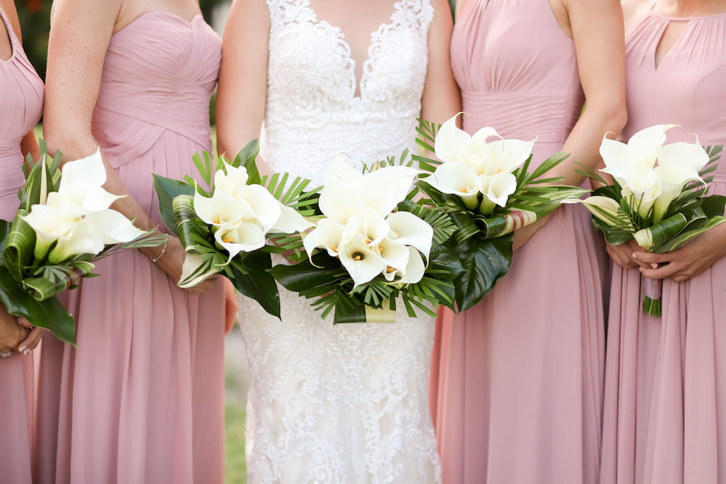 Florida Bride and Bridesmaids Outdoor Wedding Portrait, Bridesmaids in Mismatched Style Dusty Rose Dresses, Bride in Lace Fitted Sweetheart Neckline and Tank Top Strap Wedding Dress with White Cala Lily Floral Bouquets | St. Pete Photographer LifeLong Photography Studios