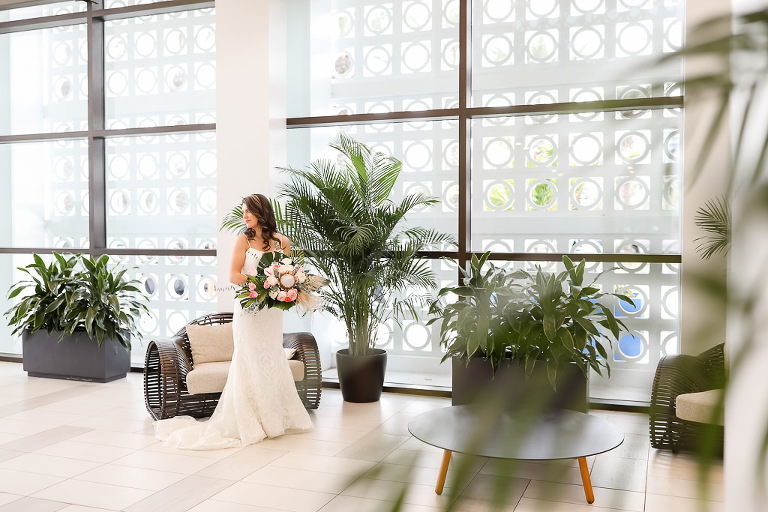 White and Pink Flower Bouquet with Green Palms, Florida Bridal Portrait, Bride in Spaghetti Strap Sweetheart Neckline White Fitted Hayley Paige Wedding Dress, | Photographer Lifelong Photography Studios | Hilton Clearwater Beach