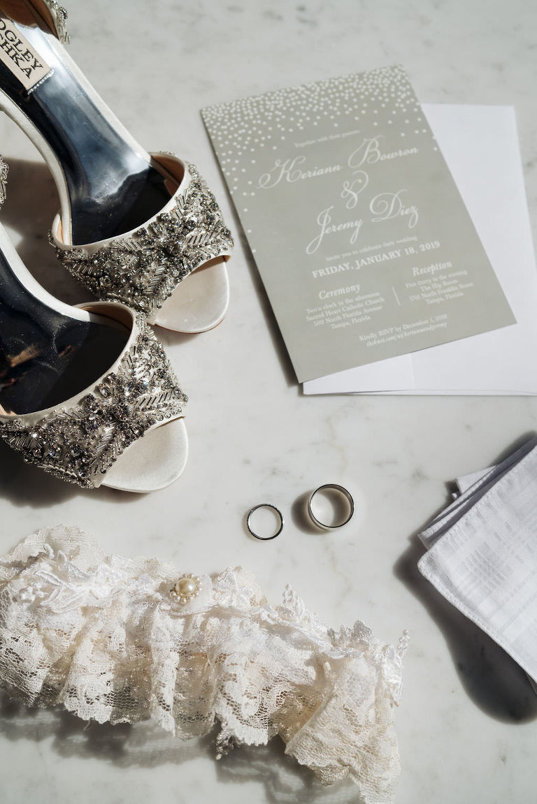 Bride Wedding Accessories and Invitation, Badgley Mischka High Heel Peep Toe Shoes, Romantic Wedding Invitation, White Lace and Pearl Brooch Garter, Wedding Rings, White Pocket Square | Photographer Grind & Press Photography