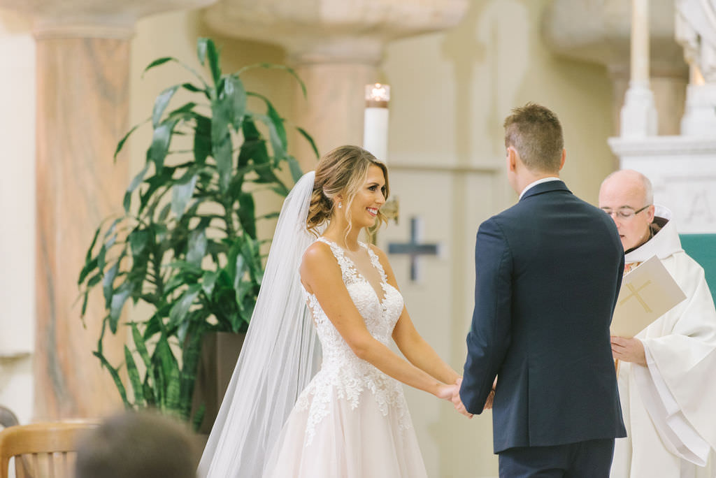 Tampa Bay Bride and Groom Exchanging Vows Wedding Ceremony Portrait   Photographer Kera Photography   Traditional Wedding Ceremony Venue Sacred Heart Catholic Church