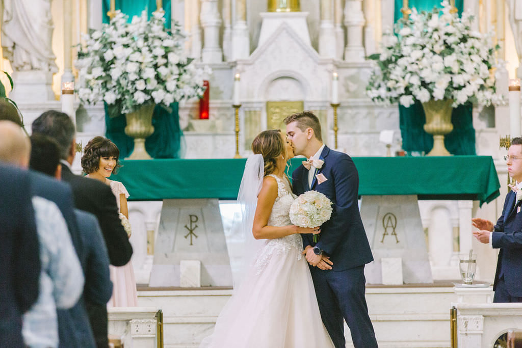 Tampa Bay Bride and Groom First Kiss Wedding Ceremony Portrait   Photographer Kera Photography   Traditional Wedding Ceremony Venue Sacred Heart Catholic Church