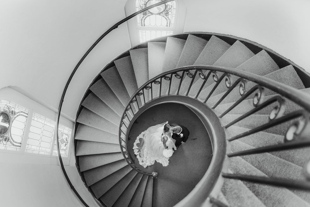 Black and White Bride and Groom Wedding Portrait on Swirl Staircase   Photographer Kera Photography   Tampa Bay Wedding Ceremony Venue Sacred Heart Catholic Church
