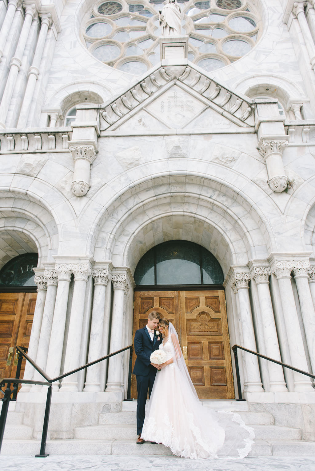 Florida Bride and Groom Outdoor Wedding Portrait on Staircase Outside Traditional Tampa Wedding Ceremony Venue Sacred Heart Catholic Church   Photographer Kera Photography