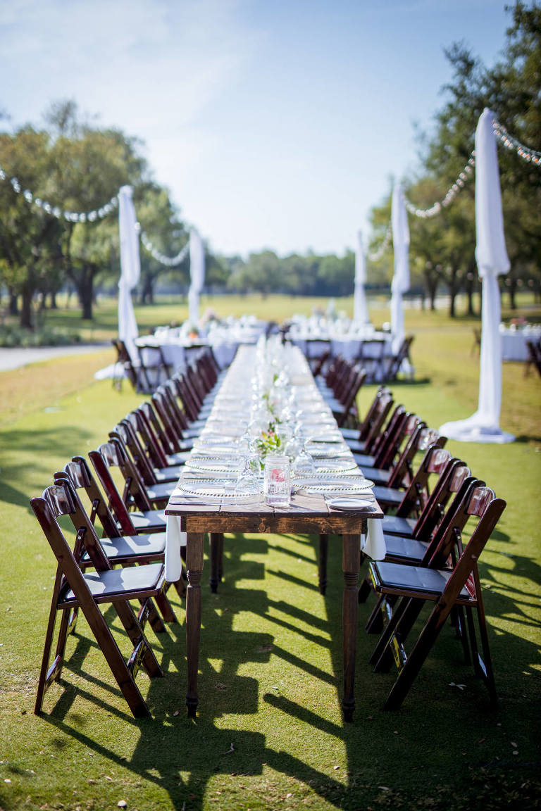 Rustic Southern Chic Garden Wedding Decor, Long Runner Table with Wooden Folding Chairs, Outdoor String Lights with Draping, Tampa Wedding Venue Palma Ceia Golf & Country Club | Tampa Bay Wedding Planner Jessie Soplinski with Breezin' Weddings