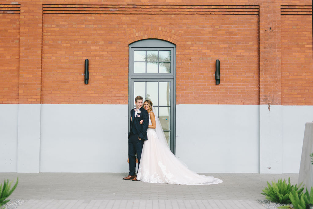 Florida Bride and Groom Wedding Portrait Outside Industrial Tampa Heights Wedding Venue Armature Works   Photographer Kera Photography