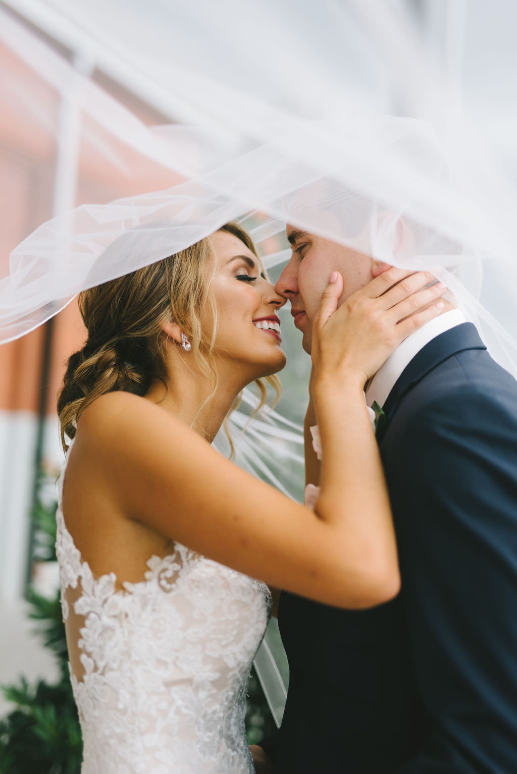 Intimate Bride and Groom Wedding Portrait with Veil Blowing in Wind   Tampa Wedding Photographer Kera Photography