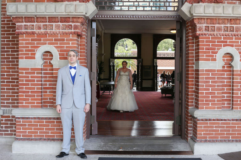 Tampa Bay Bride and Groom First Look Wedding Portrait, Bride in Strapless Sweetheart Neckline Rhinestone Crystal Embellished A-Line Style Wedding Dress, Groom in Light Gray and Bold Blue Tuxedo