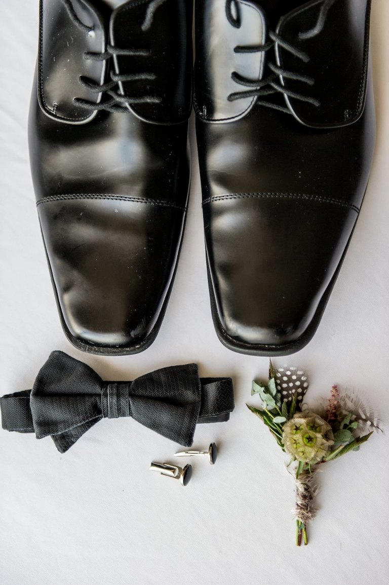 Groom's Classic Black Accessories Wedding Detail Portrait, Black Formal Shoes, Black Bowtie, Black Cufflinks, Multi-colored and Textural Floral Boutonniere with Scabiosa, Feathers and Pampas Grass | Tampa Bay Wedding Photographer Andi Diamond Photography | Tampa Bay Wedding Planner UNIQUE Weddings + Events