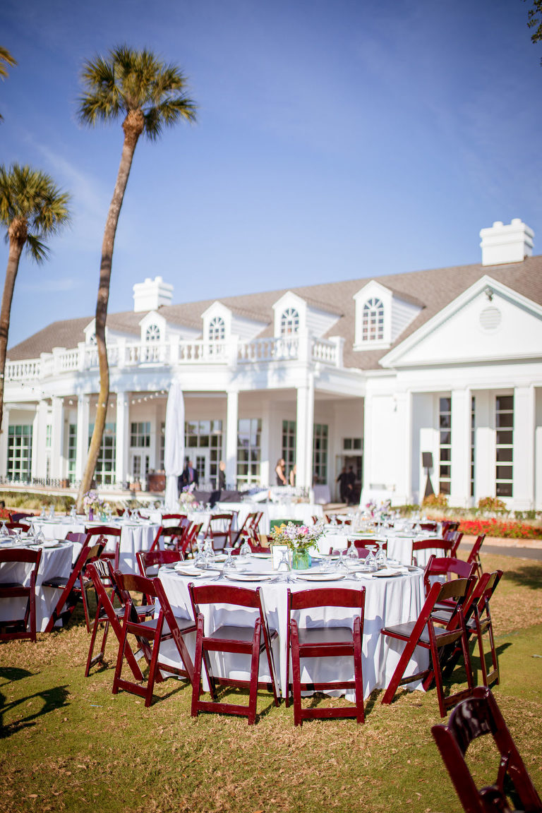 Rustic Southern Chic Garden Wedding Decor in Backyard Reception in South Tampa, White Round Tables with Wooden Folding Chairs, Colorful Centerpieces, at Palma Ceia Golf & Country Club | Tampa Bay Wedding Planner Jessie Soplinski with Breezin' Weddings