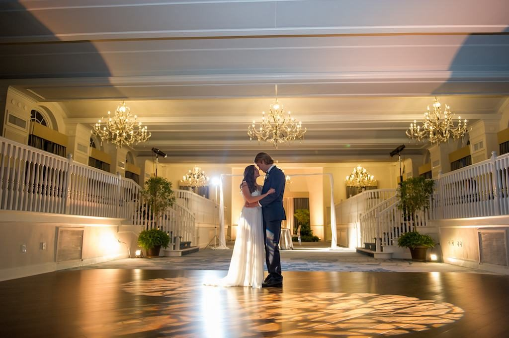 Bride and Groom First Dance During Intimate Wedding Portrait | Bride in Long Flowy White Dress, Standing in Ballroom under Chandeliers and Mood Lighting | Tampa Bay Wedding Photographer Andi Diamond Photography | St. Pete Beach Wedding Venue The Don Cesar | Wedding Dress Shop Truly Forever Bridal