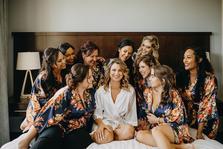 Florida Bride and Bridesmaids Getting Ready Wedding Portrait in Matching Navy, Peach and Green Floral Robes | Tampa Bay Wedding Courtyard by Marriott St. Petersburg Downtown