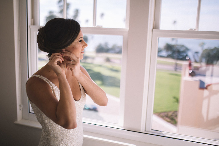 Bridal Getting Ready Portrait, Florida Bride Wearing Elegant White Sequin Sleeveless Wedding Dress with Classic Low Bun Updo Hairstyle | Tampa Bay Boutique Hotel Wedding Venue Fenway Hotel | Tampa Wedding Makeup and Hair Artist Femme Akoi